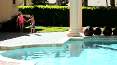 Young Kids Fun in Home Pool Stock Footage