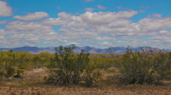 HD 1080 30p zoom in Spring in Arizona high desert with puffy clouds in timelapse Stock Footage