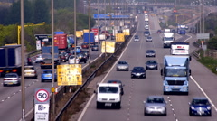 Traffic on the M1-M6 Motorway junction dual carriageway. Time lapse. - stock footage