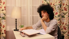 young man getting bored while studying - stock footage