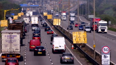 Traffic on the M1-M6 Motorway junction dual carriageway. Time lapse. Stock Footage