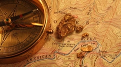 Gold nugget , compass ,topo map Stock Footage