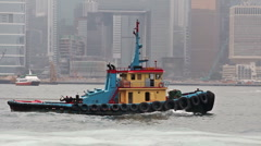 Boat passing Hong Kong harbour Stock Footage