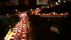 Mexico City night traffic time lapse zoomed Stock Footage
