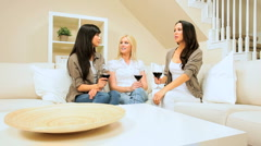 Girlfriends in Home Setting Drinking Wine Stock Footage