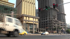 Traffic near new Sheraton building in Chongqing Stock Footage