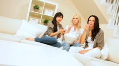 Three Girlfriends Enjoying Popcorn & Movie Stock Footage