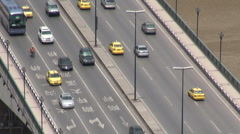 Traffic on a bridge with characters on the road, Chongqing, China - stock footage