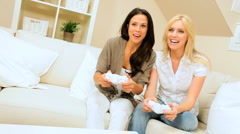 Two Young Females on Games Console - stock footage
