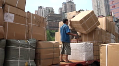 Worker loading huge box on truck in Chongqing Stock Footage