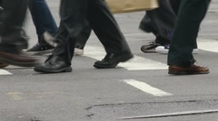 Walking feet  city street intersection Stock Footage