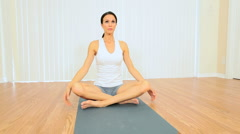 Brunette Female Practicing Yoga Stock Footage