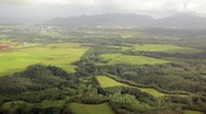 Aerial view over green fields Stock Footage