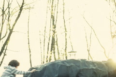 Young boy climb to the top of a rock and raise his hands into air NTSC - stock footage