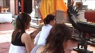 Wat Intharawihan, praying women in front of standing gold buddha Stock Footage