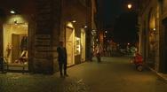 Glidecam man on phone, Rome street Stock Footage