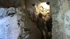 Italy Rieti La Foresta cave with man 2 Stock Footage