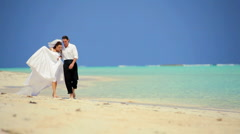 Caucasian Couple in Wedding Clothes on a Beach Stock Footage