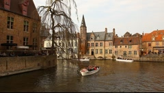 Canal and boats in the historic center of Bruges, Belgium Stock Footage
