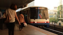 Sky train, BTS departing from the Siam station in downtown Bangkok Stock Footage