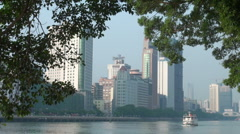 Ferry sailing over Pearl river with Guangzhou skyline backdrop Stock Footage