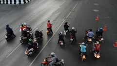 Motor scooters waiting for the traffic signal on intersection in Bangkok Stock Footage