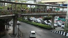 Pedestrians walking on a skyway in downtown Bangkok Stock Footage