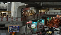 Pedestrians walking on skyway and traffic jam in downtown Bangkok Stock Footage