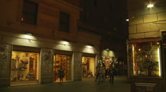 Busy back street near statue of Bruno, Rome, Glidecam Stock Footage
