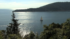 Italy Cinque Terra reflections and sailboat Stock Footage
