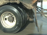 Stock Video Footage of Big Rig Snow Plow Wheel Close Up