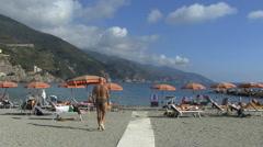 Italy Cinque Terra man and umbrellas Stock Footage
