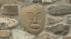 Italy Liguria face in stone wall zoom out Stock Footage