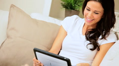 Brunette Girl Using Wireless Tablet at Home Stock Footage