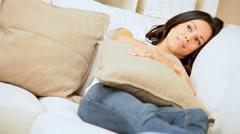 Girl Relaxing on Couch Watching Movie Stock Footage