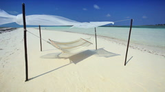 Hammock Swaying over Tropical White Sands Stock Footage
