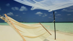 Swaying Hammock Over Paradise Beach Stock Footage