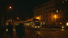 Tram at night in Rome - slow motion Stock Footage