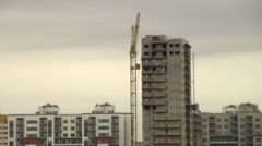 Crane at a construction site Stock Footage