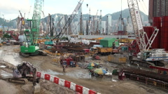 Building site in front of Hong Kong skyline Stock Footage