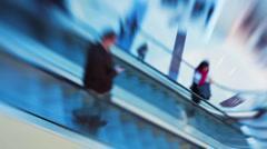 Shopping mall people on escalator walkway, blurred Stock Footage