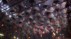 Burning Chinese incense in the beautiful Man Mo temple in Hong Kong Stock Footage