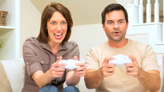 Caucasian Couple Playing on Games Console - stock footage