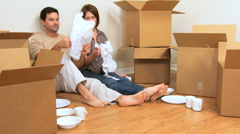 Caucasian Couple Surrounded by Moving Boxes Stock Footage