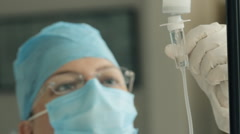 Nurse Controlling IV Drip (HD) Stock Footage