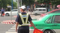 Traffic police waving traffic in Guangzhou, China Stock Footage