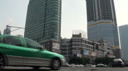 Stock Video Footage of Traffic passing shopping mall in Guangzhou
