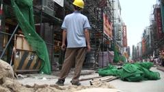 Worker looking up in Guangzhou shopping street (tilt) Stock Footage
