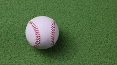 Baseball rolling into the frame Stock Footage