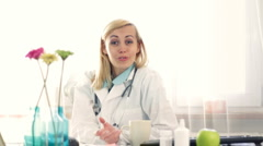 Female doctor in the office talking to camera, giving advice HD Stock Footage